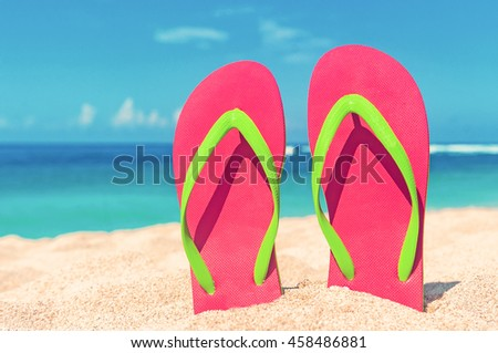 Beautiful beach. Beach sandals on the sandy coast. Summer holiday and vacation concept. - stock photo