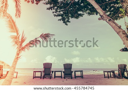 Beautiful beach chairs on tropical white sand beach - Filtered image processed vintage effect - stock photo