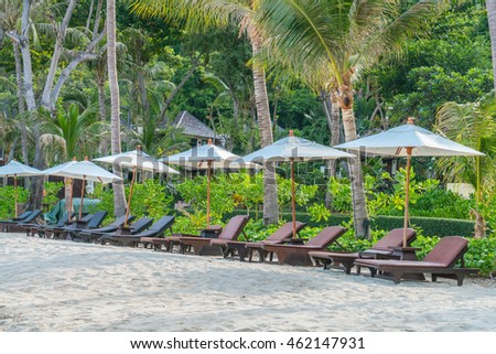 Beautiful beach chairs with umbrella on tropical white sand beach