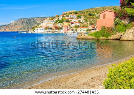 Beautiful beach in Assos fishing village with port, Kefalonia island, Greece - stock photo