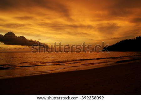 Beautiful beach in evening time. Orange sunset in ocean coast
