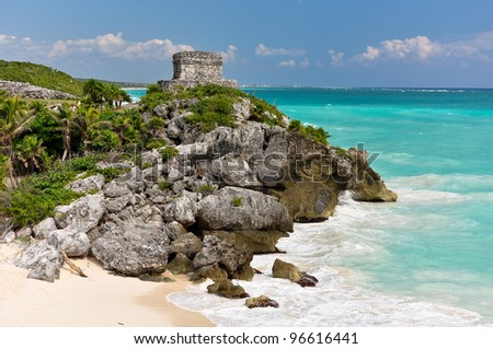 Beautiful beach in Tulum Mexico, Mayan ruins on top of the cliff. - stock photo