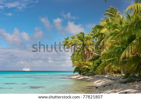 Beautiful beach of Fakarava with the ship in the background, French Polynesia - stock photo