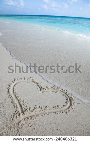 beautiful beach of maldives with heart in the sand  - stock photo