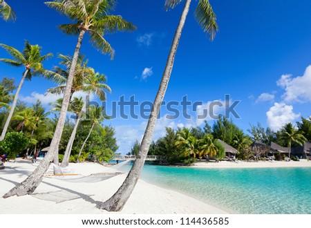 Beautiful beach on Bora Bora island in French Polynesia - stock photo