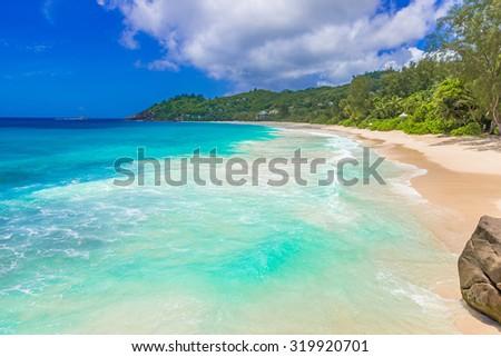 Beautiful beach on tropical island Mahe in Seychelles - Anse Intendance  - stock photo