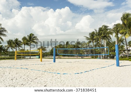 Beautiful beach volleyball, sunny day with palm trees. Florida  - stock photo