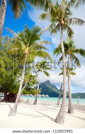 Beautiful beach with a view of Otemanu mountain on Bora Bora island - stock photo