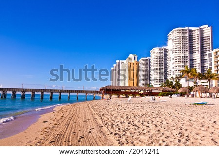 beautiful beach with appartments and skyscrapers at Sunny Islands, Miami early morning - stock photo