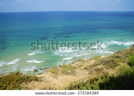 beautiful beach with blue water and white sand in Montenagro, view from the top