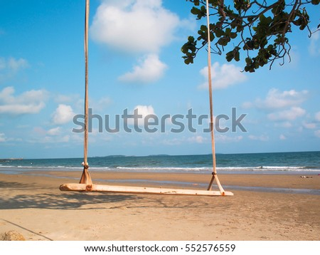 Beautiful beach with brown sand and blue sky in background in sunny day