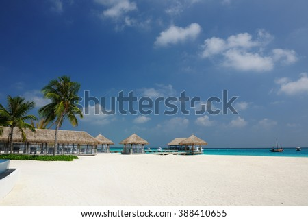Beautiful beach with bungalow jetty at Maldives