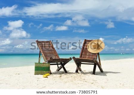 Beautiful beach with chaise lounge - stock photo