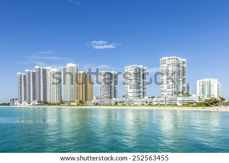 beautiful beach with condomiums and skyscraper in Sunny Islands, Miami - stock photo