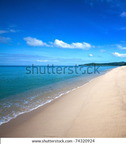 Beautiful beach with crystal clear blue waters of the Andaman sea - stock photo