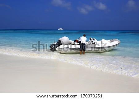 Beautiful beach with motor boat and traveler at Ko Ta Chai  island, Thailand - stock photo