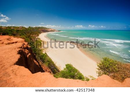 Beautiful beach with palm trees at Praia do Amor near Pipa Brazil - stock photo