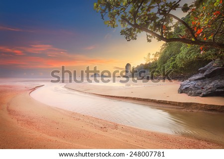 beautiful beach with river and colorful sky at sunrise or sunset, Thailand - stock photo