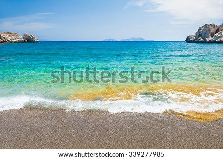 Beautiful beach with turquoise water and cliffs. Crete island, Greece. - stock photo