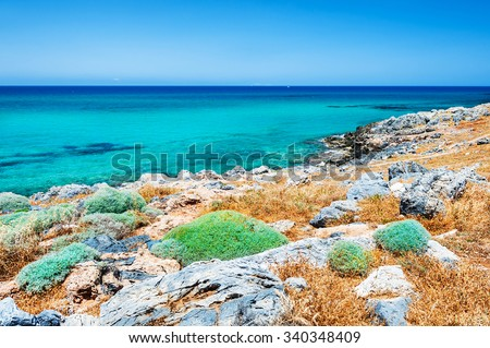 Beautiful beach with turquoise water and volcanic stones. Crete island, Greece. - stock photo