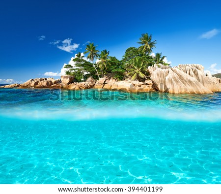 Beautiful beach with white sand bottom underwater and above water split view - stock photo