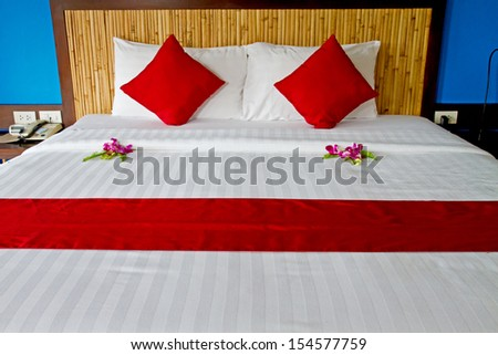 Beautiful bed in traditional Thai setting  - stock photo