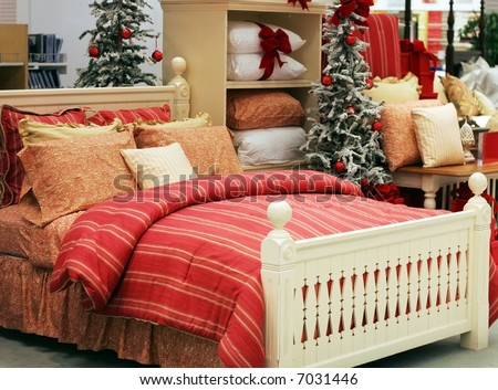 beautiful bed with autumn colored linens and holiday decorations - stock photo