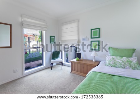 beautiful bedroom in luxurious australian house - stock photo