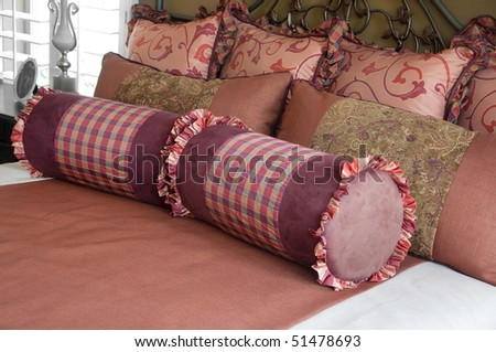 Beautiful bedroom textiles and bedding. - stock photo