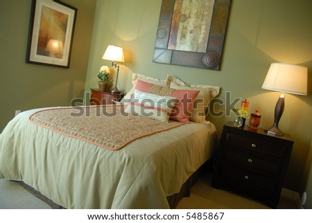 Beautiful bedroom. The use of green  sets the room apart. - stock photo