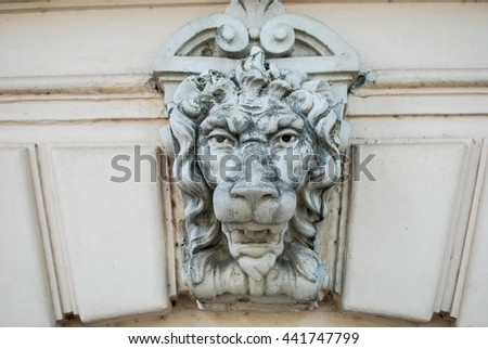 Beautiful beige lion (fretwork). Front view.