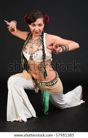 Beautiful belly dancer woman in front of black background