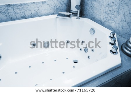 beautiful big bath in the marble bathroom - stock photo
