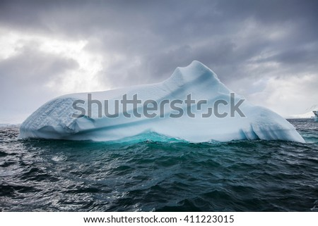 Beautiful big blue iceberg and ocean. Peculiar landscape of Antarctica  - stock photo