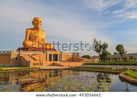Beautiful big buddha image against blue sky with cloud background