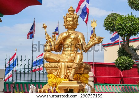 Beautiful big golden Brahma statue. Pattaya, Thailand. - stock photo