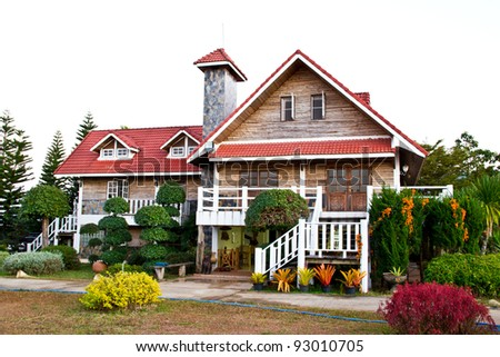 beautiful big red house in the mountain - stock photo