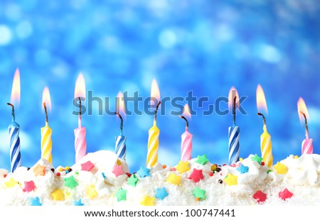 beautiful birthday candles  on blue background