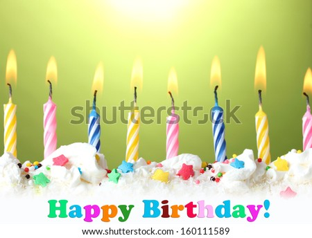 beautiful birthday candles  on green background - stock photo