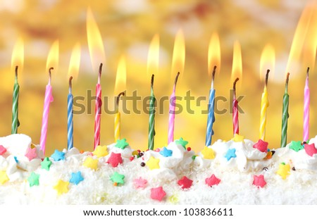beautiful birthday candles  on yellow background - stock photo