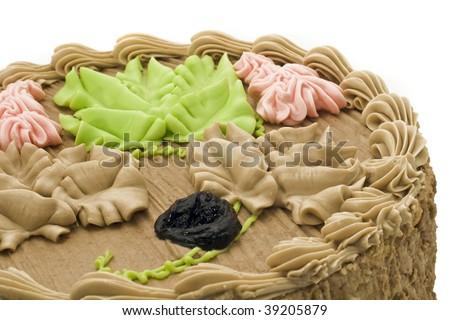 Beautiful birthday chocolate cake with prune and cream pattern (shallow DOF) - stock photo