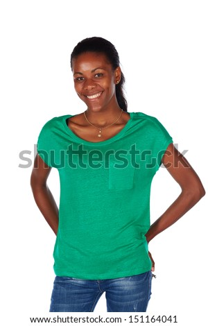Beautiful black african young adult woman casually dressed in an emerald green t-shirt and Blue jeans and with her hair slicked back into a ponytail and isolated on a white background - stock photo