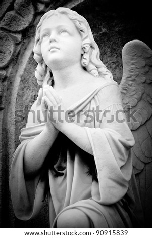 Beautiful black and white image of a marble angel in an old gothic church - stock photo