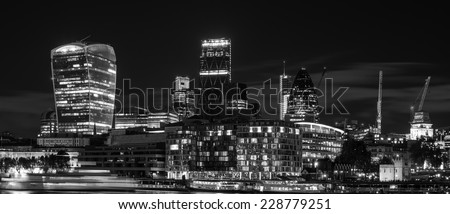 Beautiful black and white image of London City at night with lovely tones and grades - stock photo