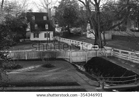 Beautiful black and white picture of  a house with a creek passing by in Williamsburg colonial town in Virginia, United States of America - stock photo