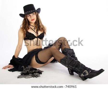 Beautiful black dressed cowgirl - stock photo