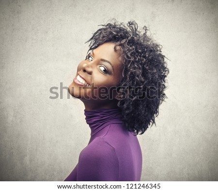 Beautiful black girl in purple - stock photo