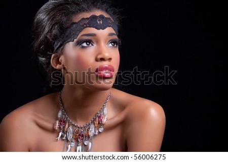 Beautiful black girl, isolated on black background - stock photo