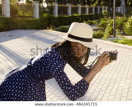 Beautiful black girl taking pictures