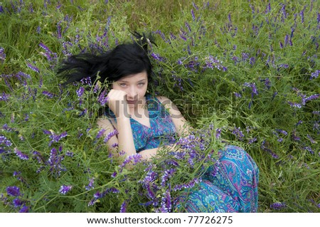 Beautiful Black Hair Girl in blue flowers - stock photo
